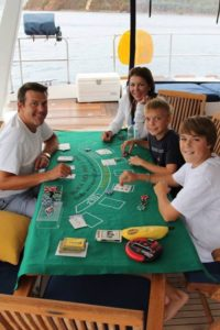 Guests play Blackjack during a rainy afternoon aboard Catsy