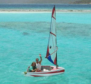 Families enjoy sailing a dinghy aboard charter yacht Milagro