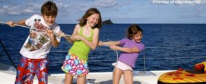 Children help with the sailing