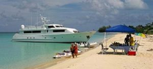 Beach party aboard a Nicholson charter yacht