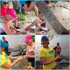 Crew teach children how to hunt for treasure buried ashore using the yacht's GPS